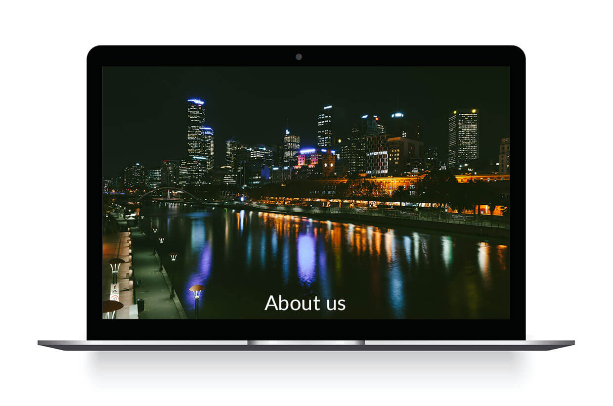 About Us - Macbook with Melbourne night cityscape