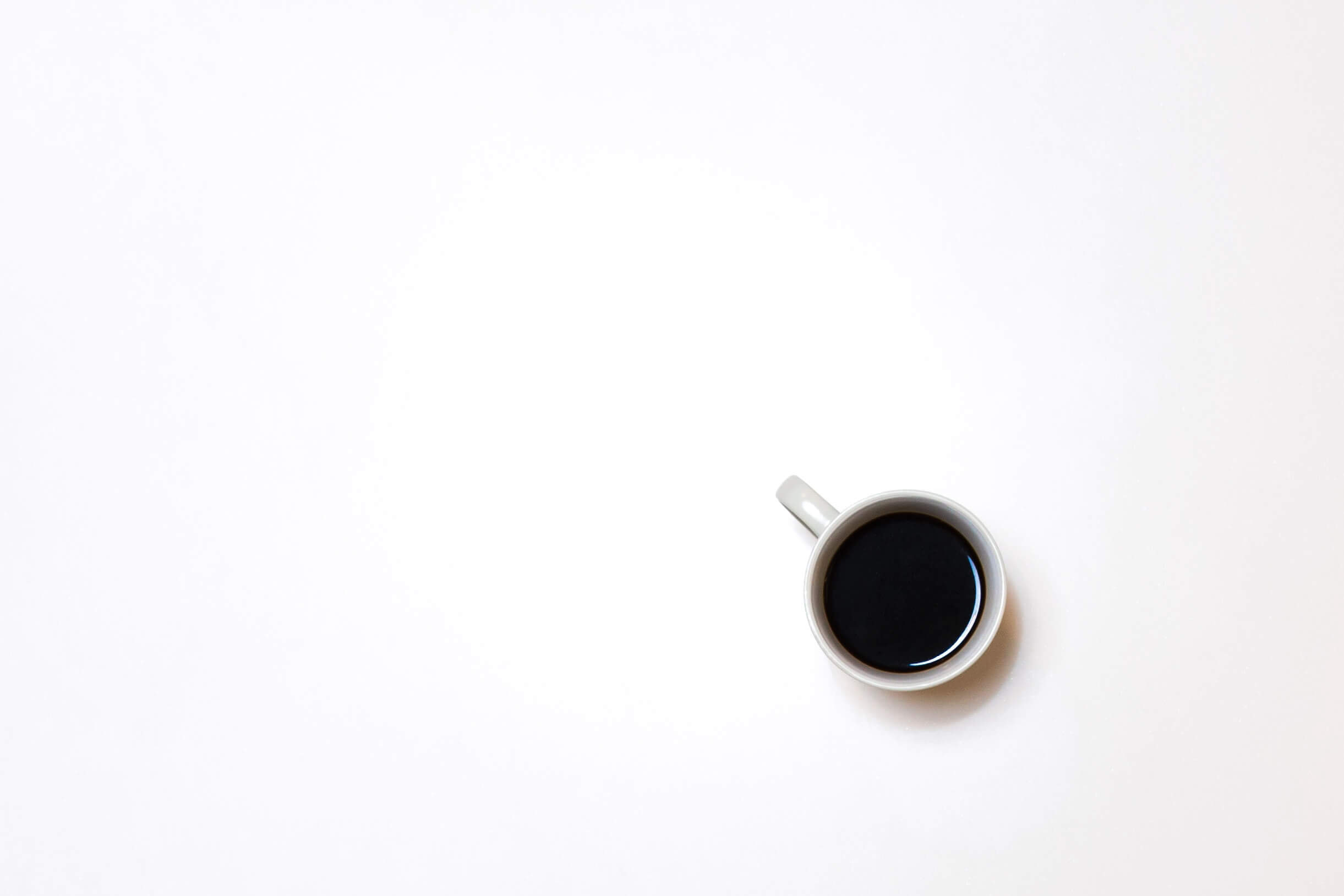 Coffee cup on white background - Photo by Isaac Benhesed on Unsplash